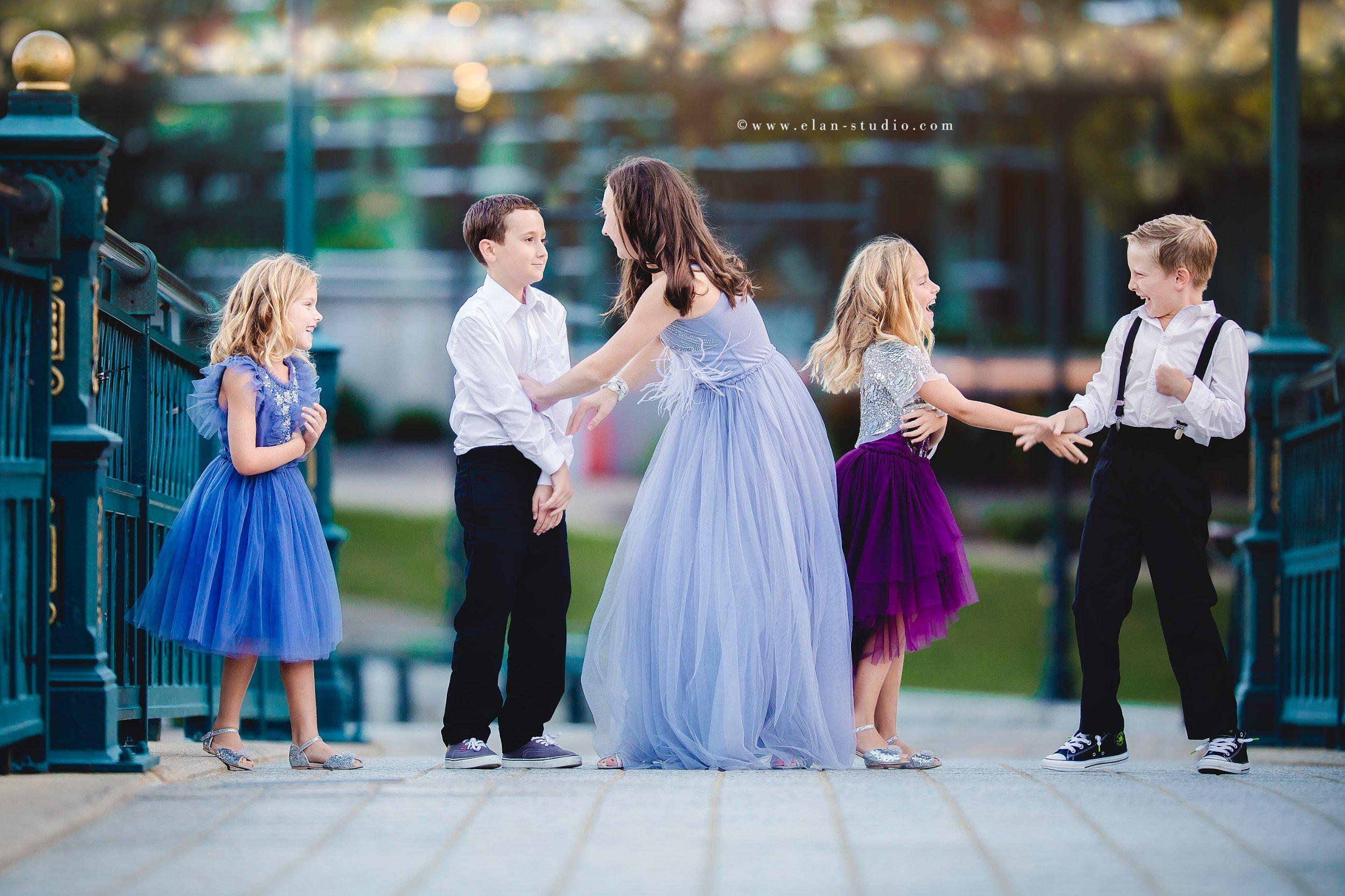 five siblings in formalwear at dusk