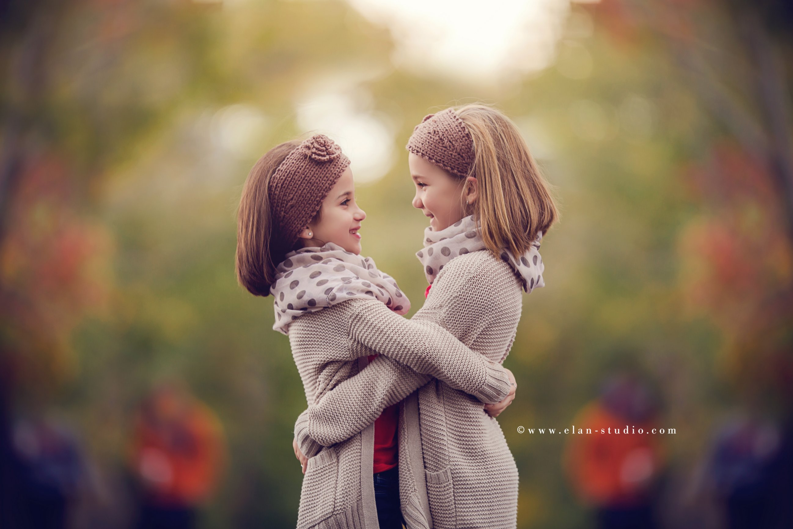 sisters embracing in fall