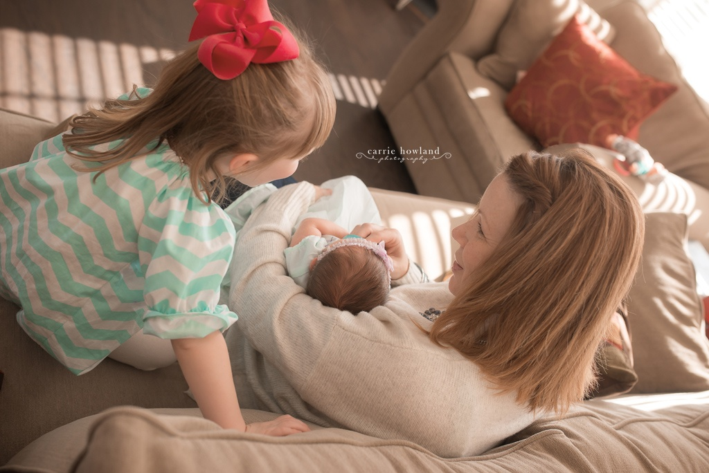 Mother with new baby and toddler girl in Charlotte, NC home for newborn photographs