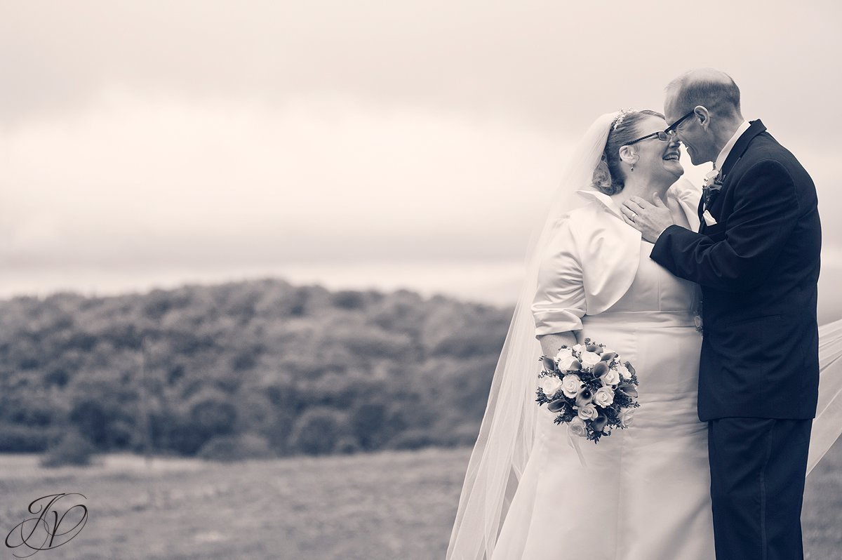 bride and groom kissing, Lake George Wedding Photographer, Wedding at The Queensbury Hotel