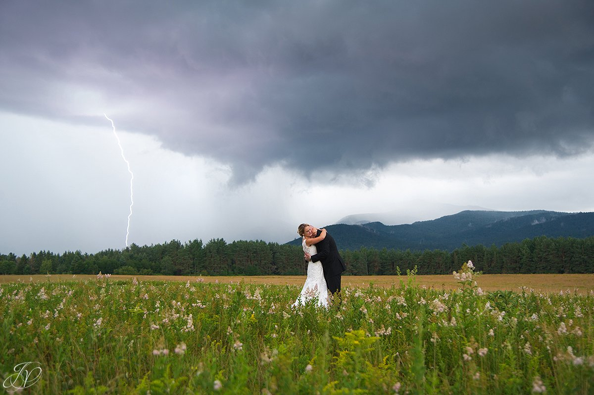 bride and groom lake placid mountain view lightening storm