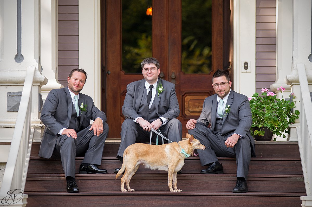 groomsmen on steps with dog