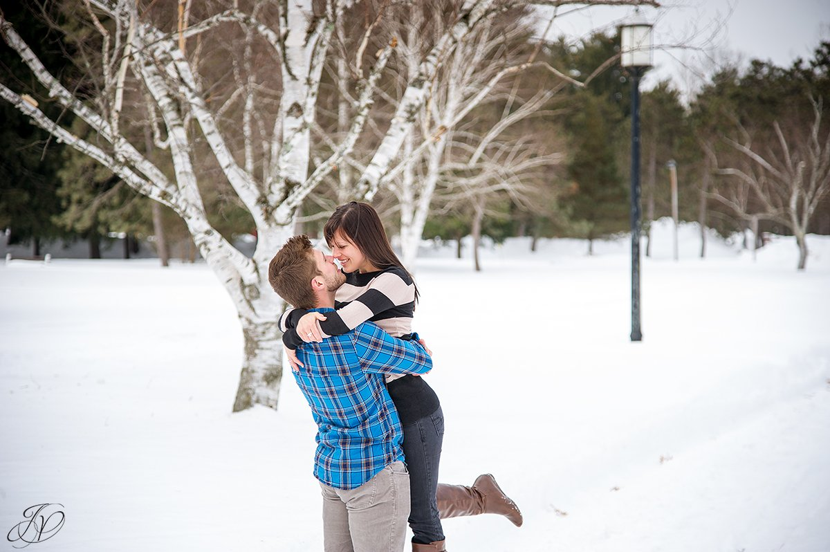photo of guy picking up his fiance in the snow
