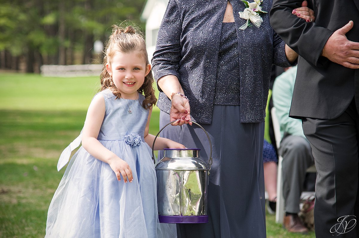 cute photo of flower girl coming down the aisle