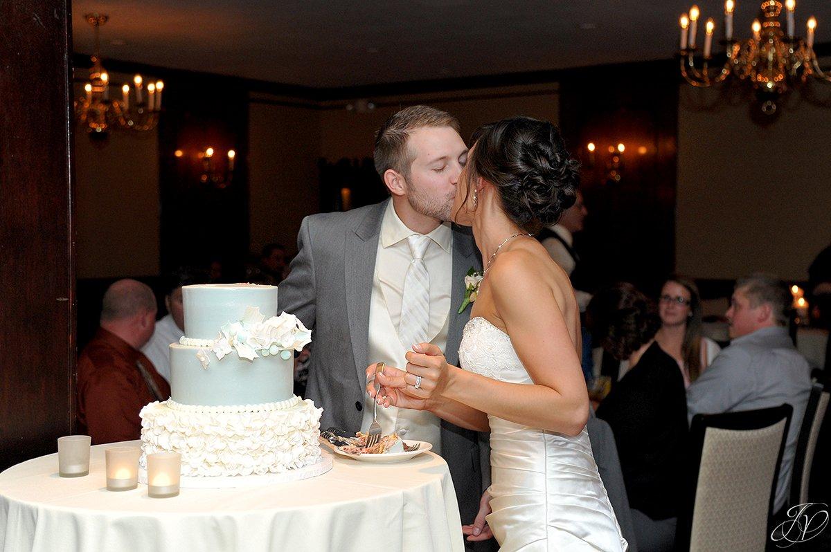fun reception cake cutting moment