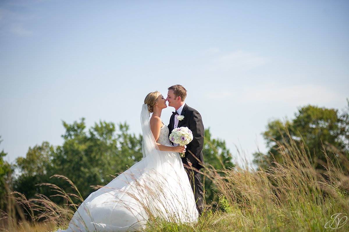 bride and groom almost kiss tall grass