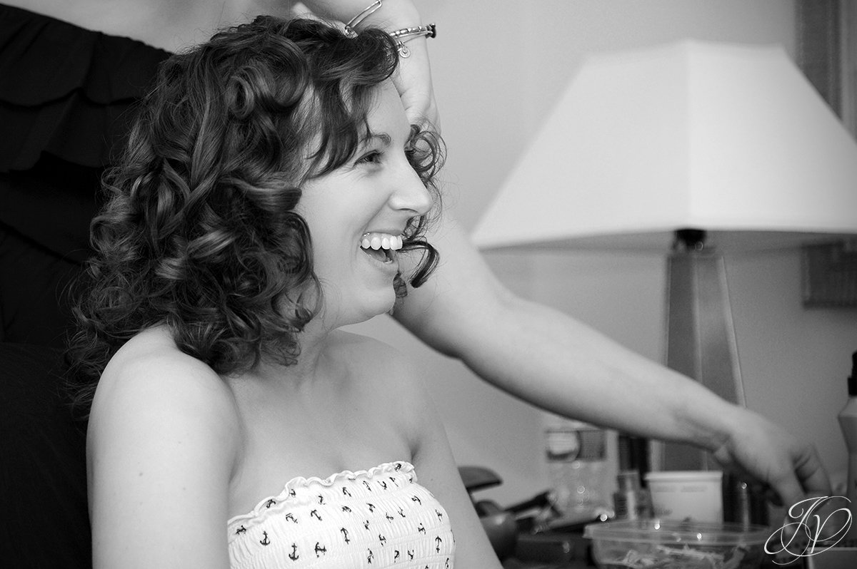 beautiful bride smiling, finishing up hair and makeup photos, Schenectady Wedding Photographerwedding at mabee Farms, Key Hall Proctors reception