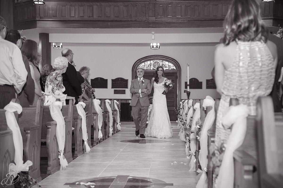 dad walking bride down the aisle at church