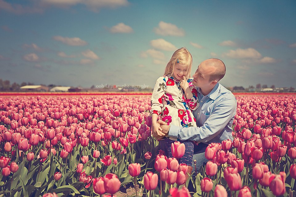 Jason and Caitlin in the tulips at Keukenhof - Houston family photographer