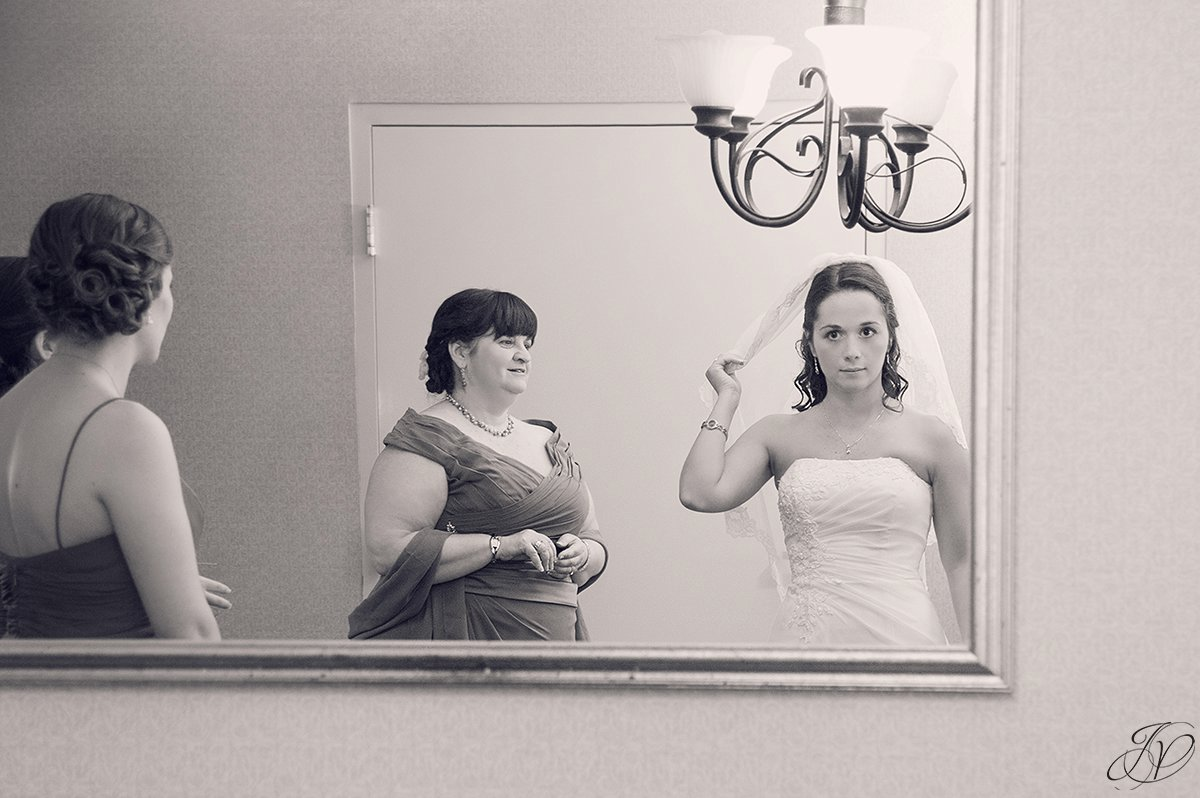 black and white photo of mom adoring the bride