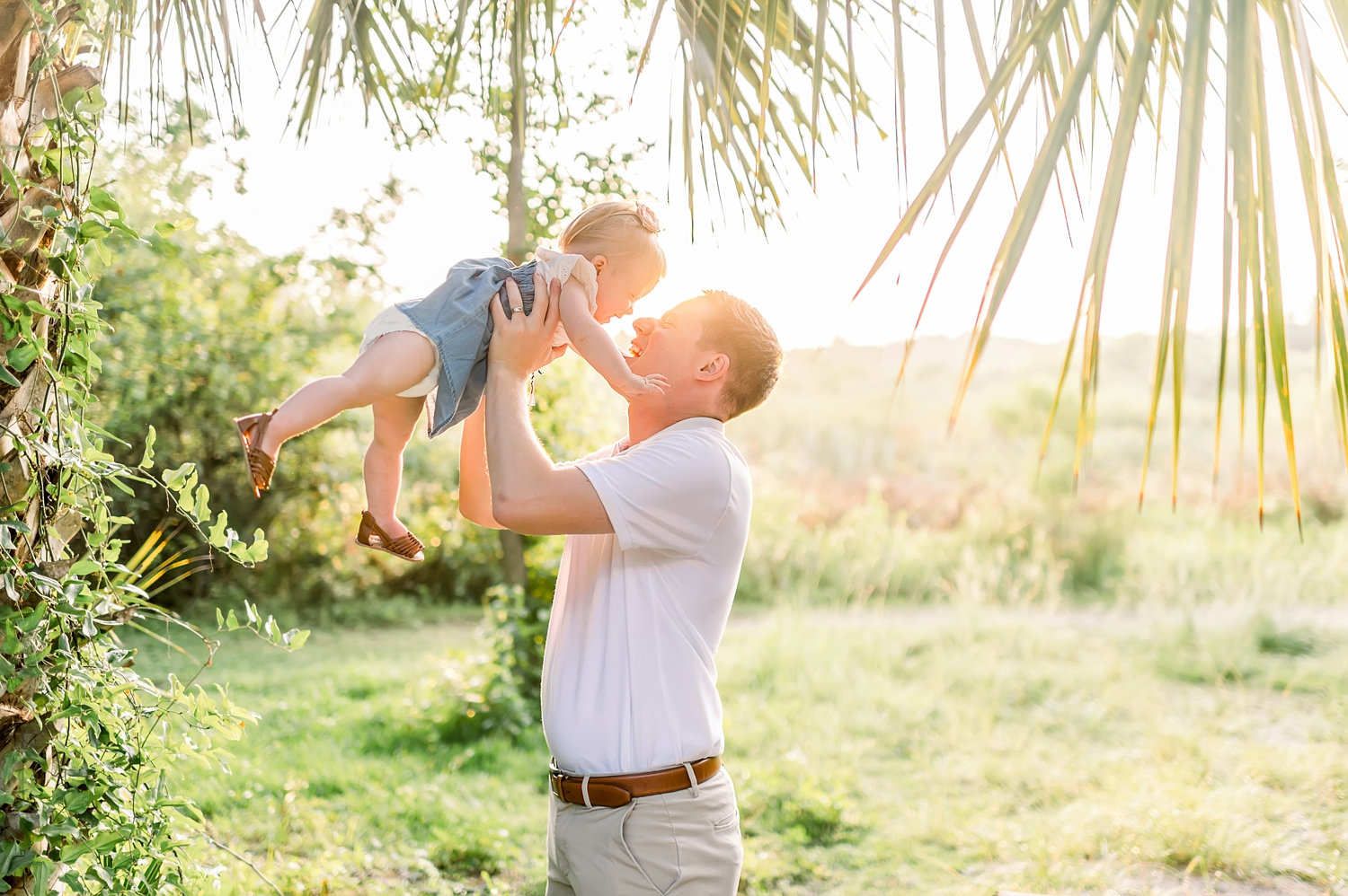 golden hour, setting sun in Florida, dad holding up baby daughter, Rya Duncklee Photography, Gainesville baby photographer
