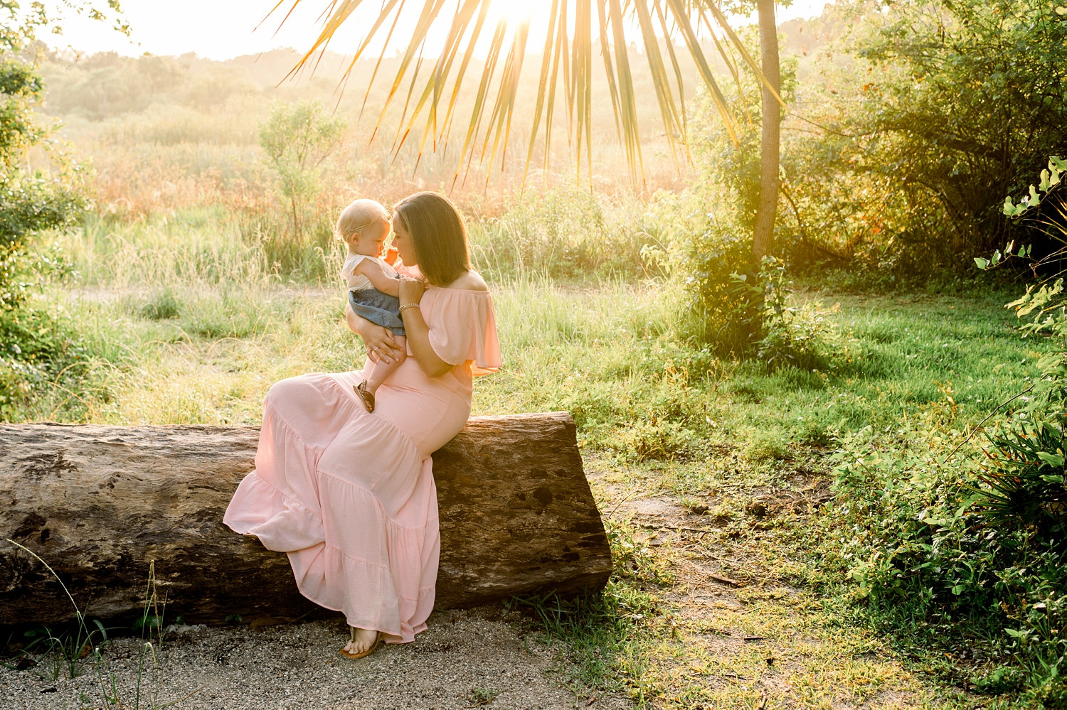mother holding baby daughter at sunrise, Gainesville family photographer, Rya Duncklee photos