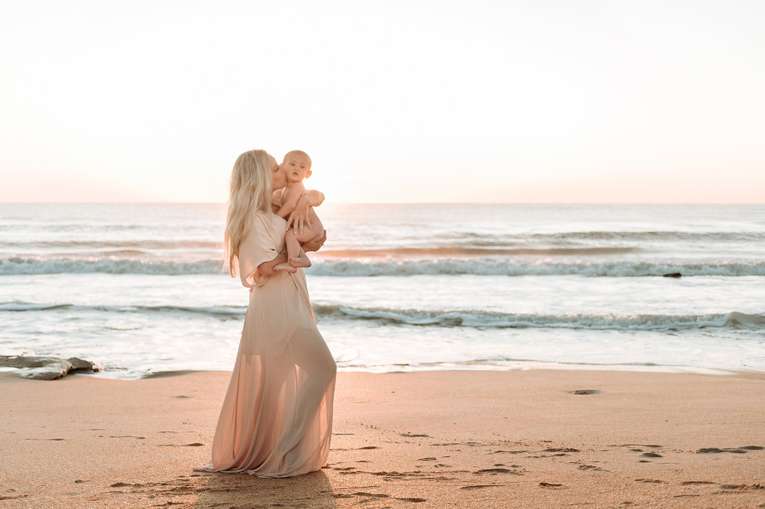 beautiful blonde mom holding baby boy on a beach, Florida, Rya Duncklee