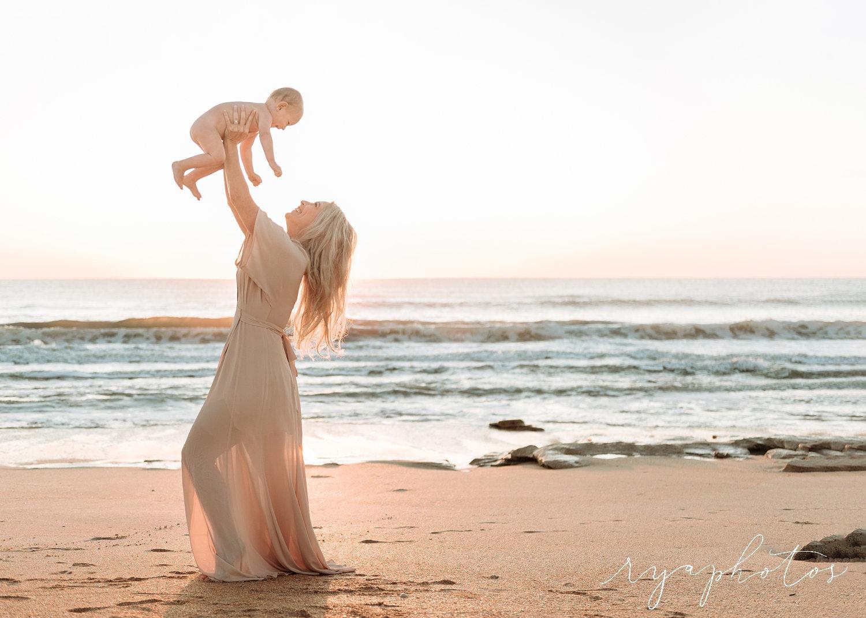 blonde mom lifting up baby boy, Atlantic Ocean, Florida coast, Rya Duncklee