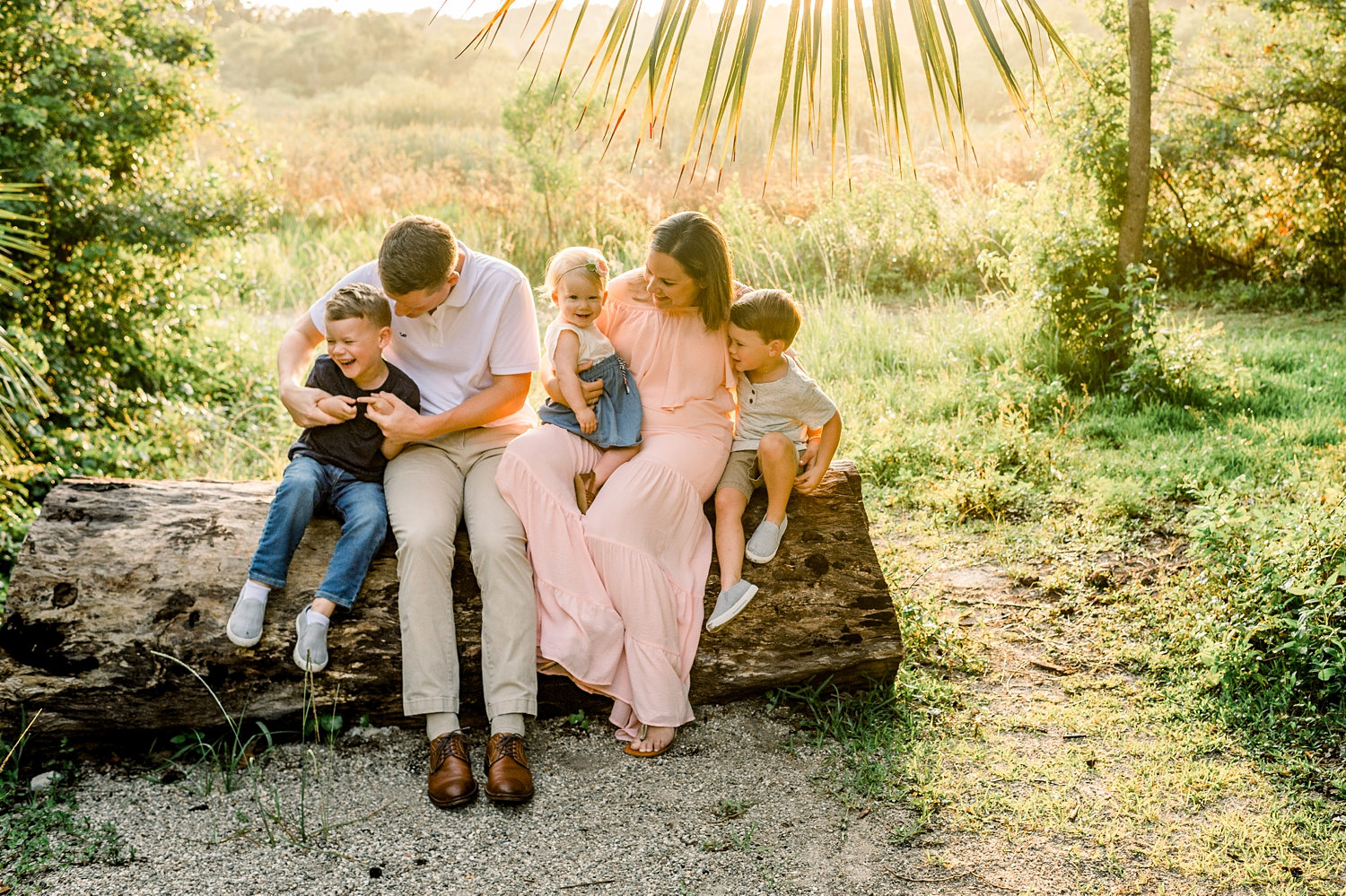 family of 5 sitting on a log, Gainesville family portrait photographer, Ryaphotos