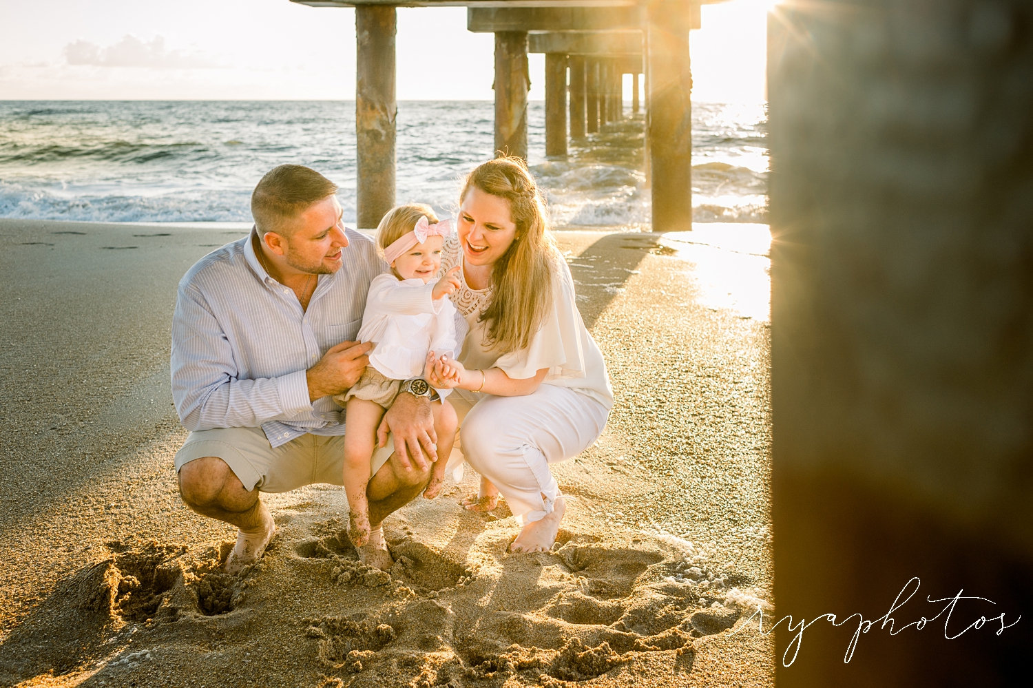 family of three, father, mother, daughter, Saint Augustine Beach, Florida