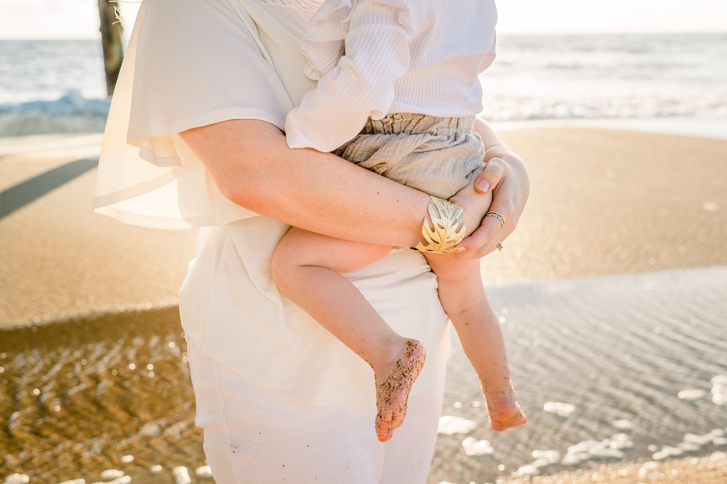 mother holding infant child, full frame image, Saint Augustine Beach, Rya Duncklee