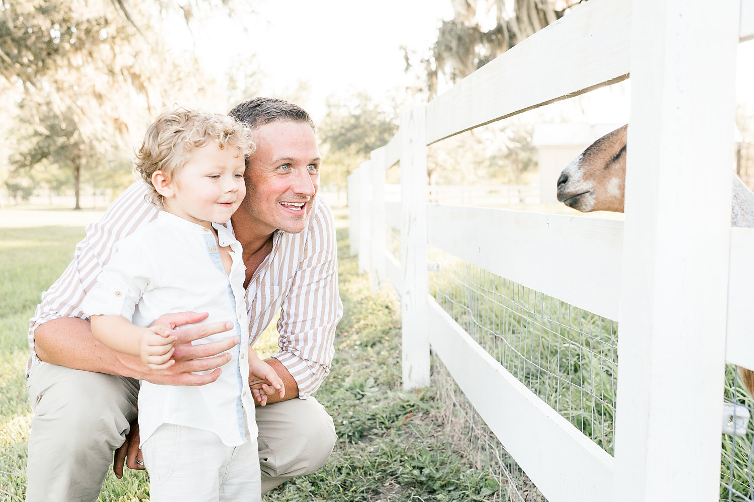 father and son, Ryan Lochte kids, goat, Congaree and Penn, farm family photo session