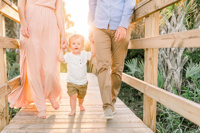 parents walking on Florida boardwalk with little boy, Ponte Vedra Beach, Rya Duncklee