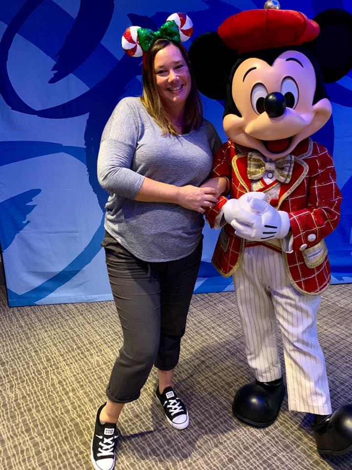 Kelly Furtado of Anchors Away Travel wearing peppermint holiday Mickey ears, Kelly Furtado with Mickey