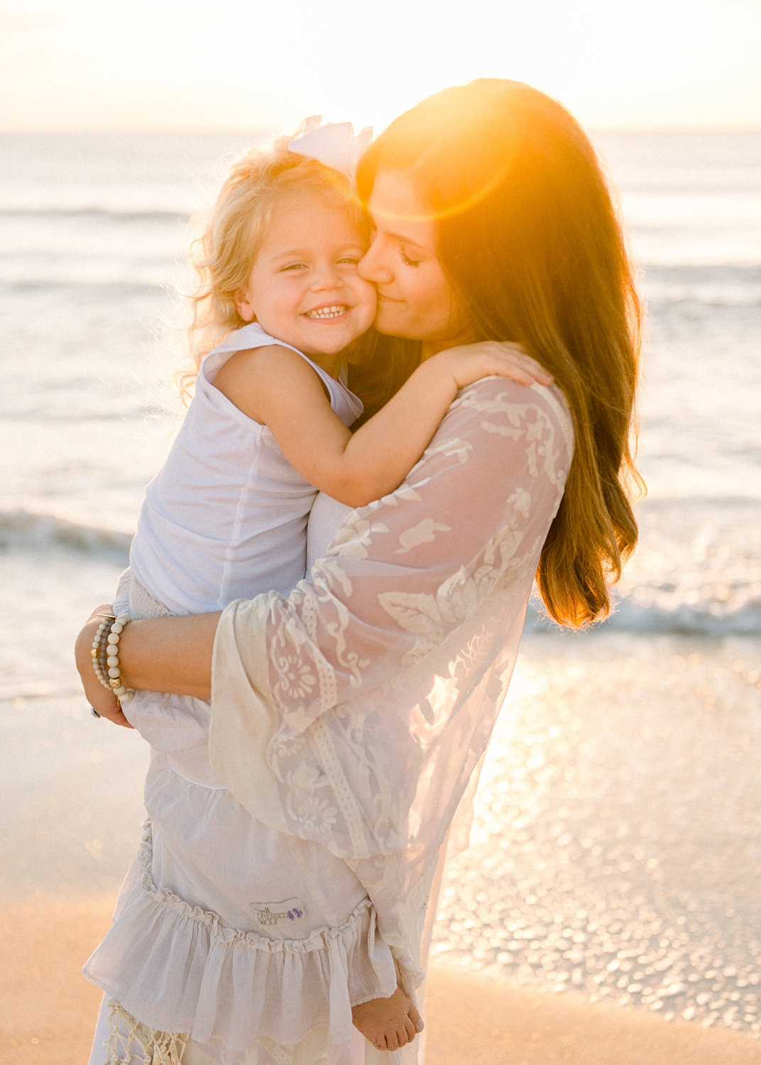 mother holding her little girl, Ponte Vedra Beach, Florida sunrise, Ryaphotos