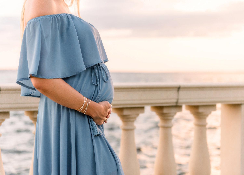 petite baby bump draped in blue, ocean, sunset, spanish architecture